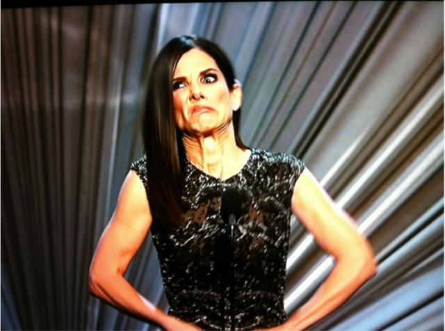 Sandra Bullock opening envelope face Oscar 2013